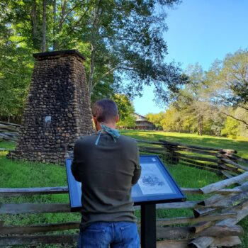 Historic remnants still stand along the trail with plaques to help educate visitors.